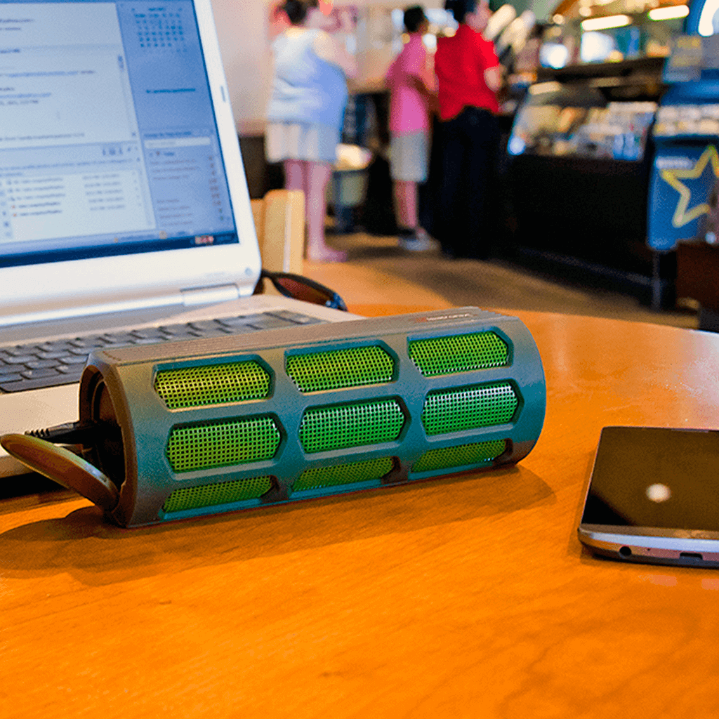 green ax410 wireless stereo speaker paired with laptop