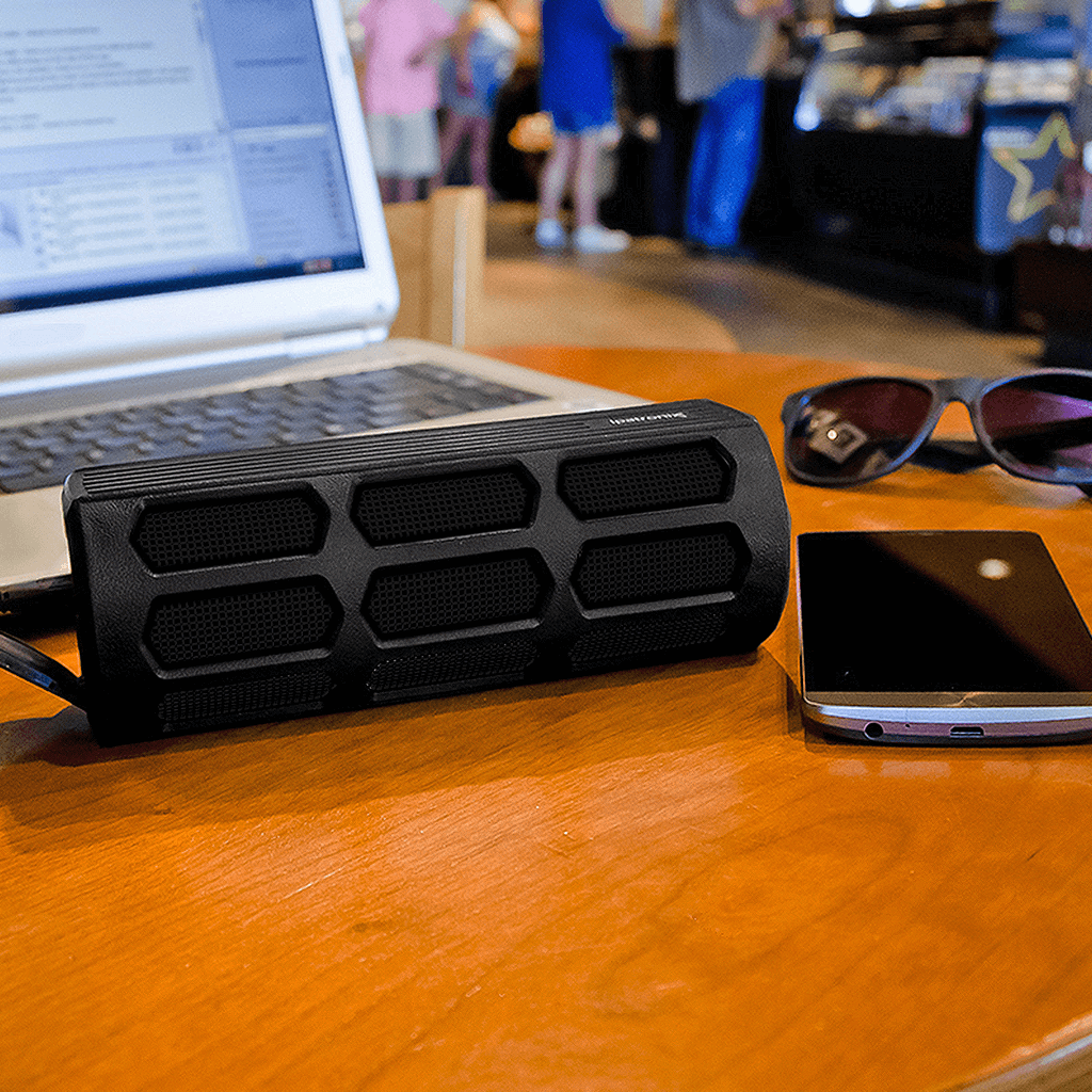 black ax410 wireless stereo speaker paired with laptop