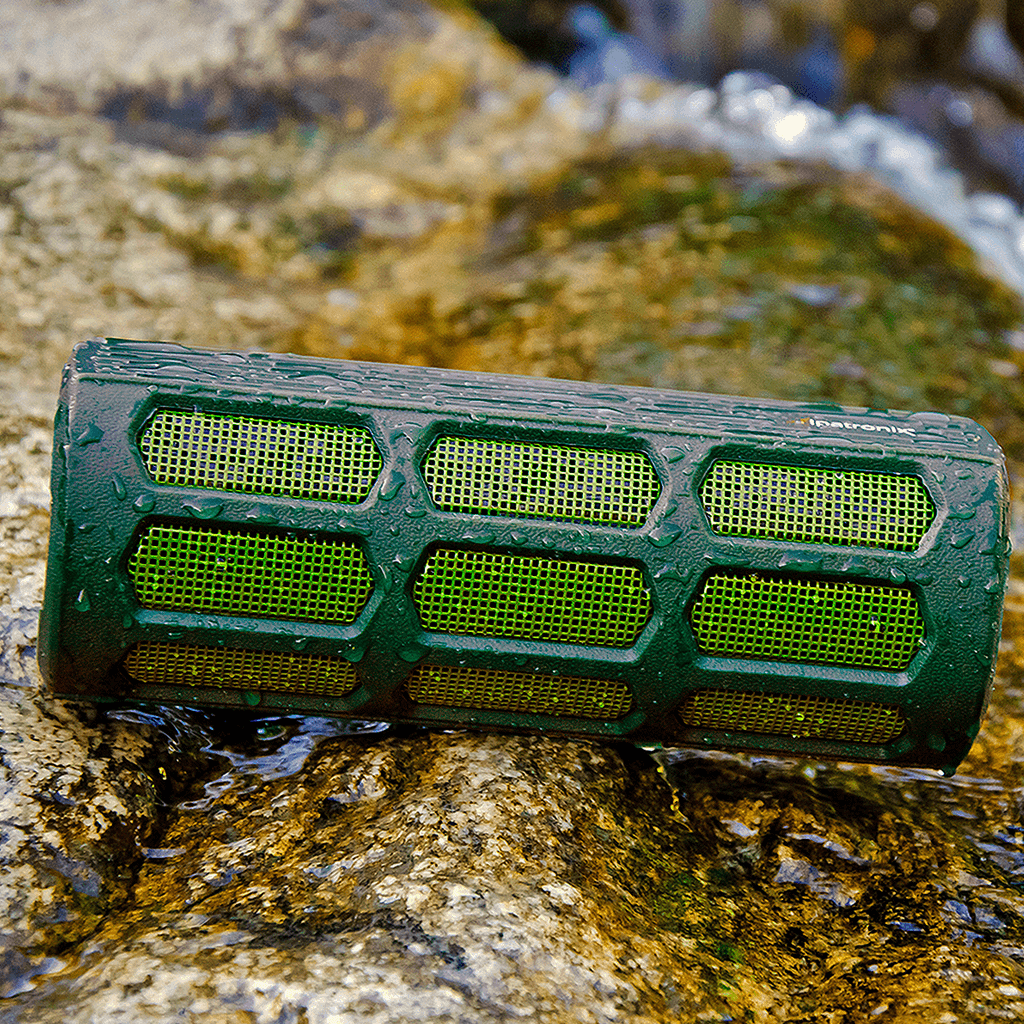 green ax410 waterproof design and splashes on speaker