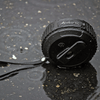 black ax320 in water puddle and in the rain