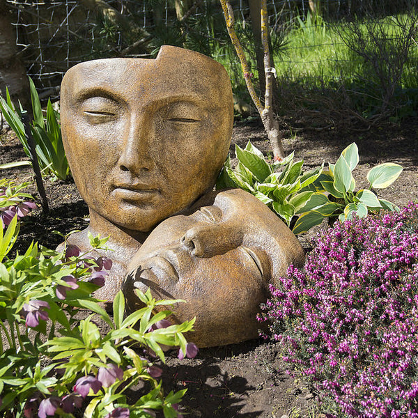 Tranquility Garden Sleeping Faces Statue in Ancient Stone