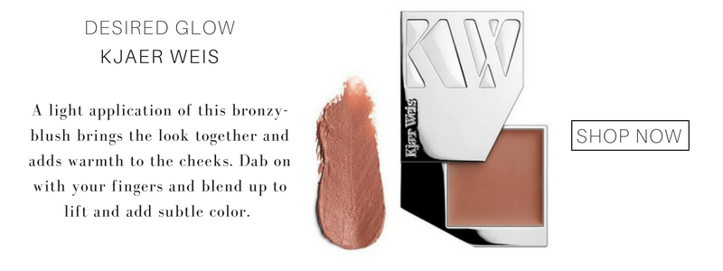 desired glow blush from kjaer weis. a light application of this bronzy blush brings the look together and adds warmth to the cheeks. dab on with your fingers and blend up to lift and add subtle color.