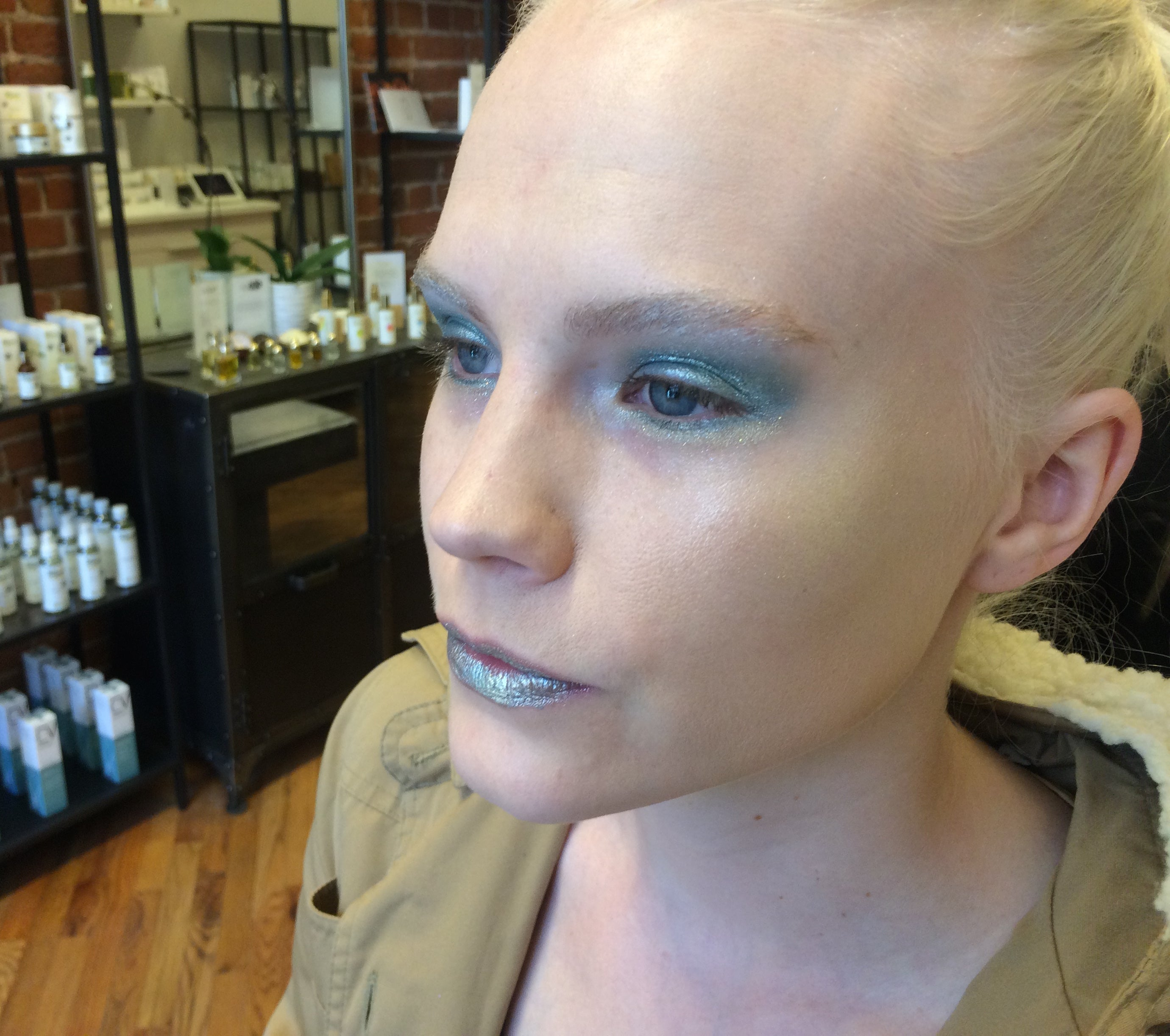 model with blue and silver makeup
