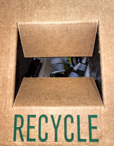 Inside of the Terracycle box: clean, empty product waste example of the Terracycle Recycling box at the AILLEA store