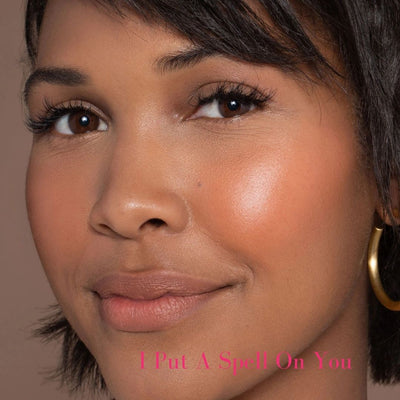 ILIA Multi-Stick - Shade: I Put a Spell On You (HOT TANGERINE WITH BRIGHT PEACHY UNDERTONES) on dark skin toned model - AILLEA