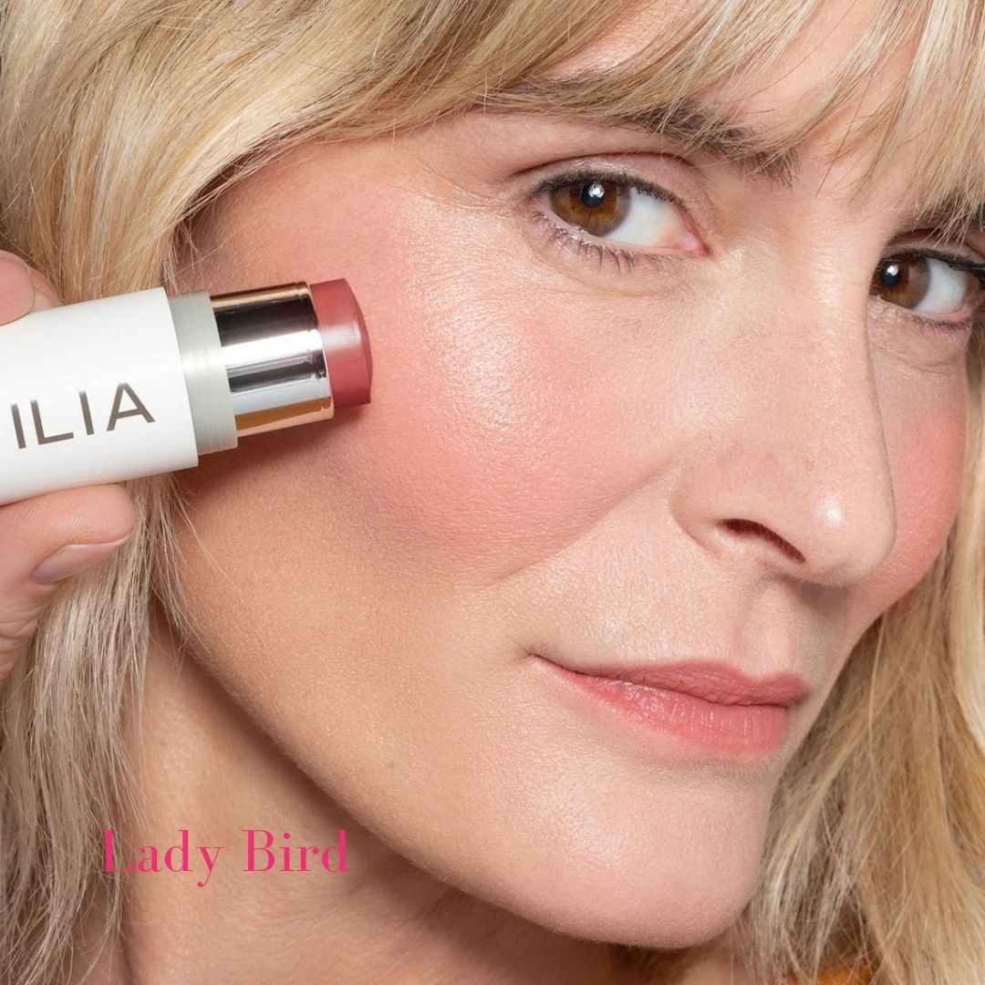 ILIA Multi-Stick - Shade: Lady Bird (NEUTRAL ROSE WITH PINK AND BROWN UNDERTONES) on light skinned model - AILLEA