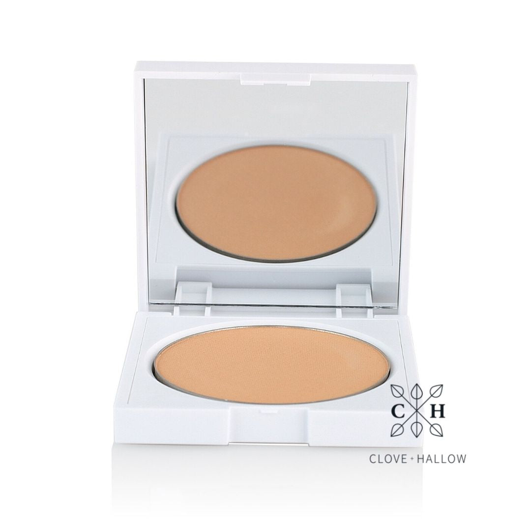 Clove + Hallow pressed mineral foundation pan inside refillable compact AILLEA
