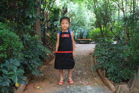 Hmong small child with Best Help apron