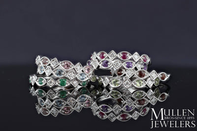 JEWELRY - 10k White Gold Diamond And Ruby Birthstone Ring