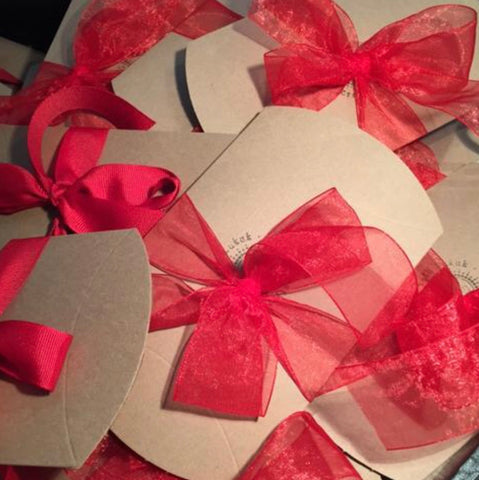 beth jewelry lil brown boxes with bright red ribbon bows
