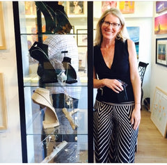 Beth Kukuk photographed next to her jewelry display in Laguna Beach gallery