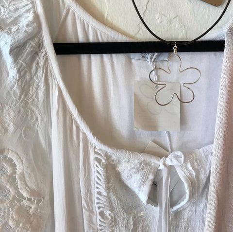 Beth Jewelry Flower Necklace and white blouse