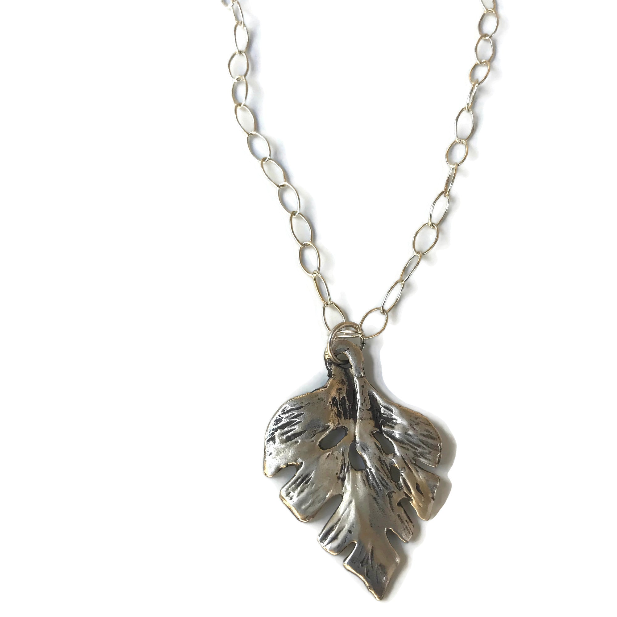 hand-sculpted silver leaf pendant on open link chain