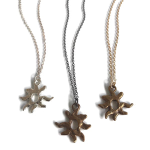 hand-sculpted small sun pendant necklaces in silver, bronze/oxidized, bronze/gold-filled