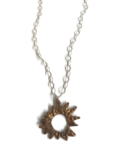bronze hand-sculpted sunburst pendant on sterling silver large open cable chain