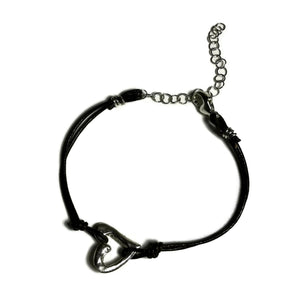 hand-sculpted small open heart charm on skinny dark brown leather bracelet