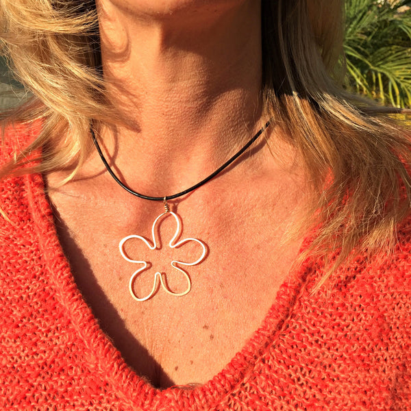 casual leather flower necklace on pretty blond model