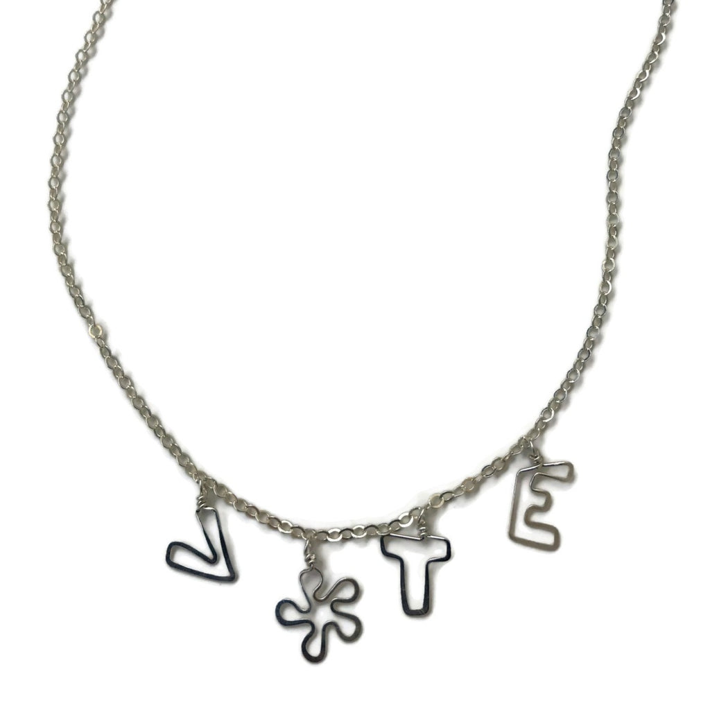 handmade VOTE necklace with flower as the O, beth jewelry