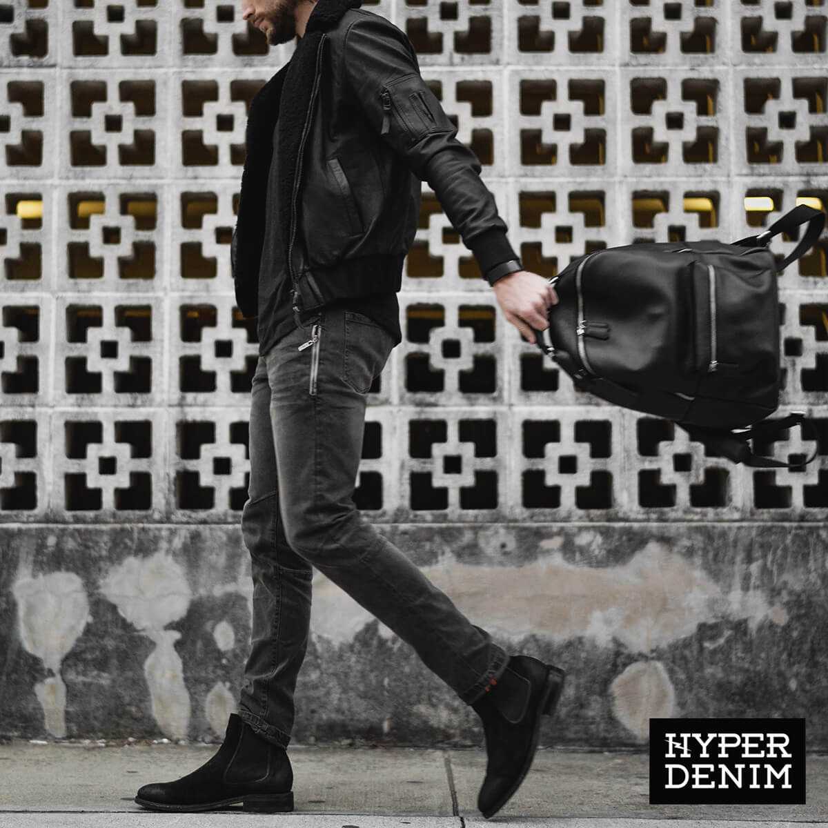 a man wearing an all black streetwear outfit