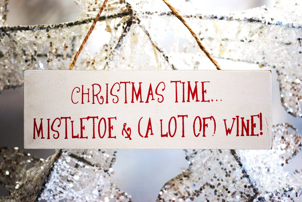 Christmas Time Mistletoe & Alot Of Wine