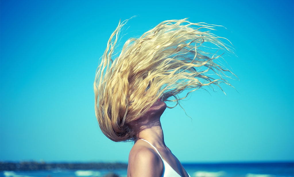How to Keep Your Strands Shiny & Healthy All Summer Long