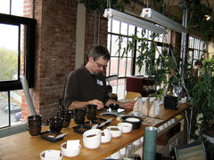 Past staff member Arthur takes part in a cupping session | Bean North Coffee Roasting Co. Ltd.