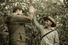 Chris Treter and a Mexican coffee producer give each other a high five | Bean North Coffee Roasting Co. ltd.
