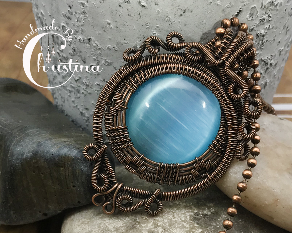 Handmade Oxidized Copper Wire Woven & Blue Fiber Optic Glass Pendant