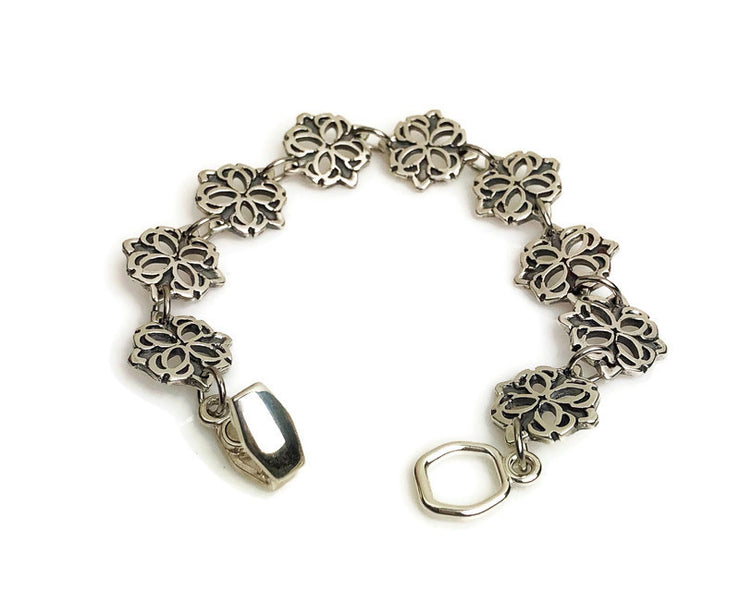 Medallion Carved Silver Bracelet