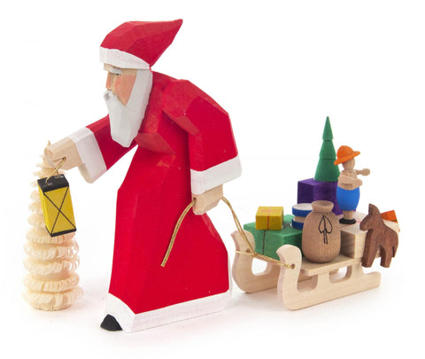 225/125/1 - Hand Carved Santa Figurine with Sled & Tree
