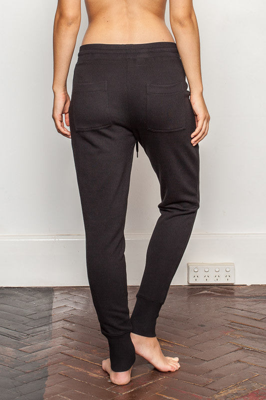 Black womens-bamboo-sweatpants with relaxed crutch and slim fit legs back view