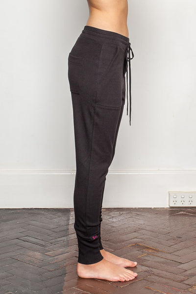 Black womens-bamboo-sweatpants with relaxed crutch and slim fit legs side view