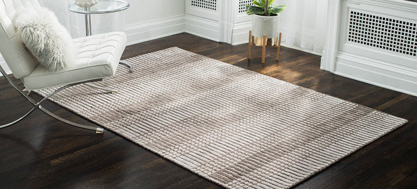 Hella Tufted Brown Area Rug