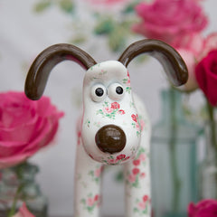 Antique Rose Gromit Unleashed Figurine by Cath Kidston. Close-up front view. Floral figurine featuring popular rose print