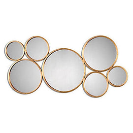 A wall mirror made from round golden metal mirrors, welded together.