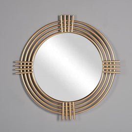 A wall mirror with four golden metal circle frames connected by four metal wires on each side.