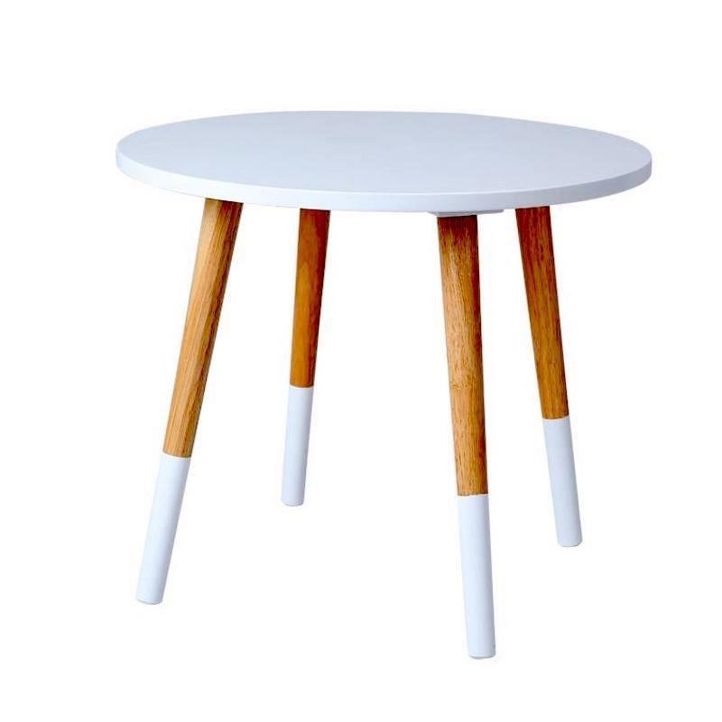 A round side table made from light wood with a white top and one-third of each of the four legs painted white.