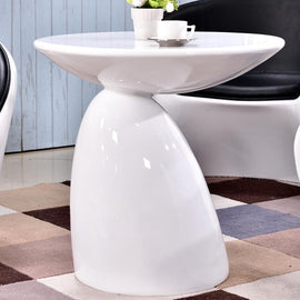 A glossy white fiberglass side table with a circle top attached to a pointed base at an off-center angle.