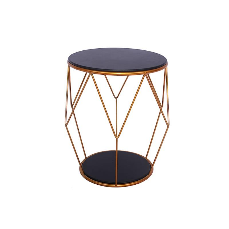 A hexagonal geometric metal-wire side table with a round solid black base and bigger black detachable table top.