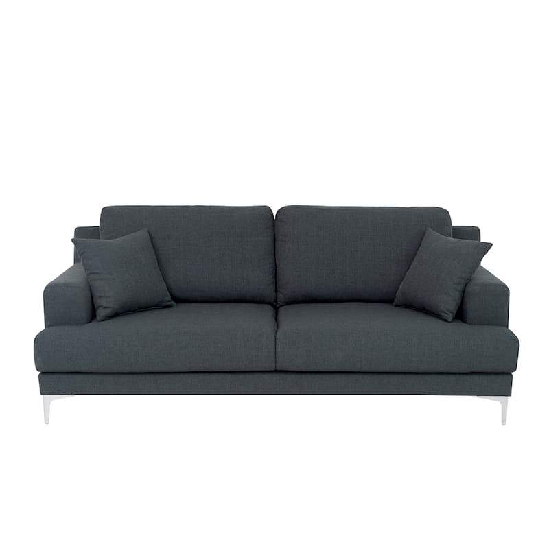 A dark grey sofa with two square scatter cushions with the same fabric and steel triangular legs.