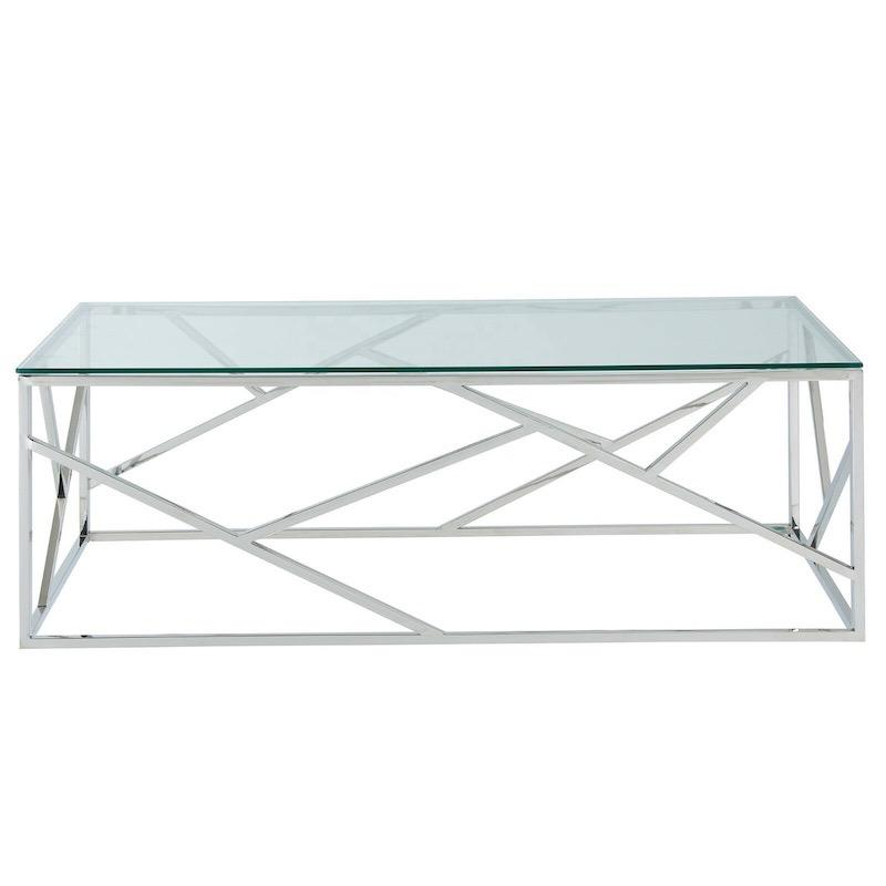 A rectangular table with a silver steel base with geometric patterned square rods and a glass top.