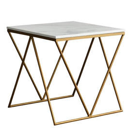 A square side table with a geometric, golden metal base design and a white marble tabletop.