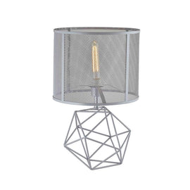 A grey metallic lamp with a geometric wire base and silver netted metal lampshade.