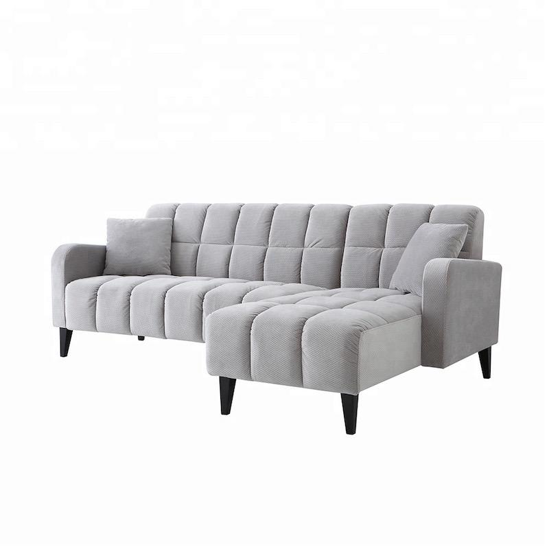 A grey two-seat and couch sectional sofa with a square-patterned padding, black wooden legs and two grey scatter cushions.