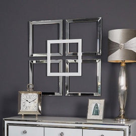 A wall decor piece made from square-shaped mirrors arranged in a window pattern connected by a slightly darker square shape mirror in the middle.