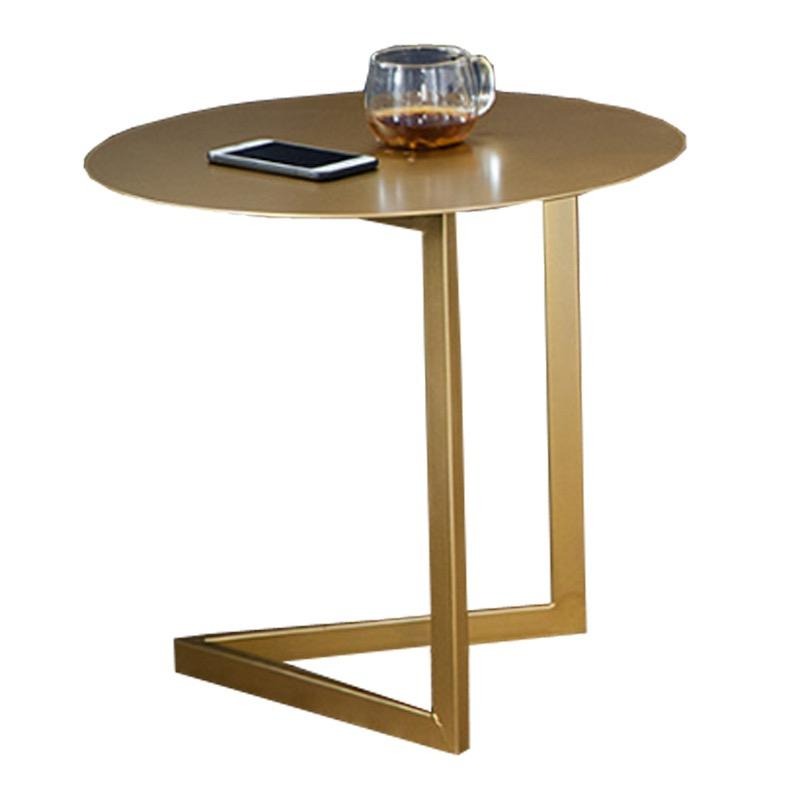 A uniformly gold-coloured accent table with a round top and two legs that connect in a triangle shape at the base.
