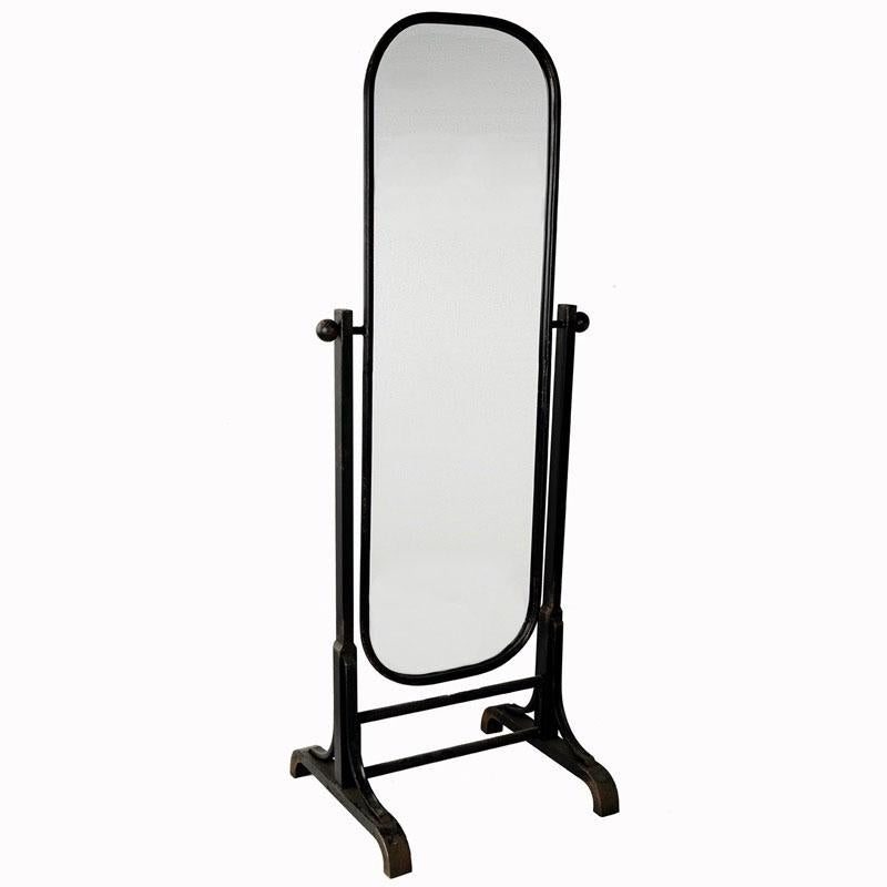 A black iron standing mirror with rounded edges and two iron bars at the bottom.