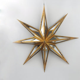 A star shaped wall decor with rusted golden frame and sleek mirror side panels.