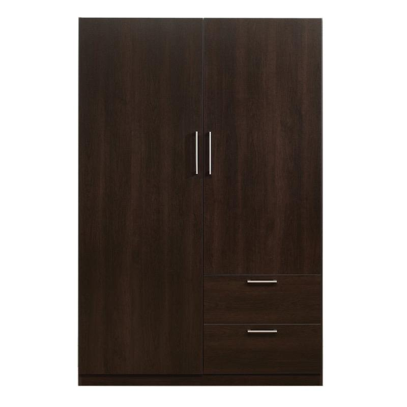 A dark wood closet with silver handles set in a large door and another smaller door above two drawers.
