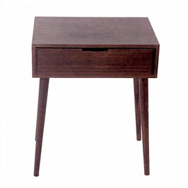 A dark wood nightstand with one drawer, a small round gold handle and four legs that tilt outward.
